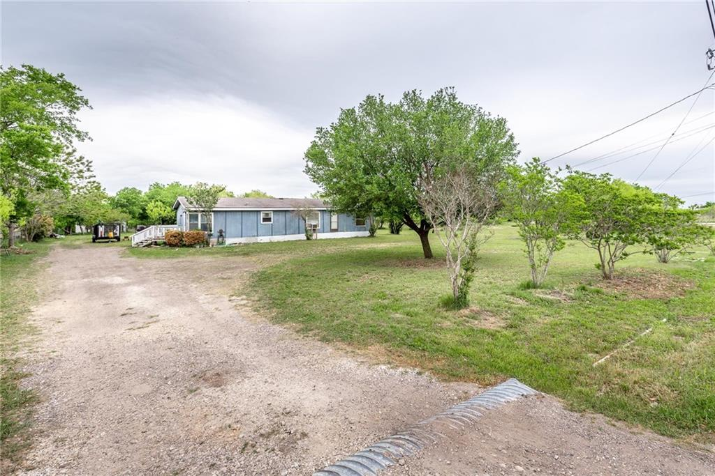 140 SE Rainbow LN Property Photo - Del Valle, TX real estate listing