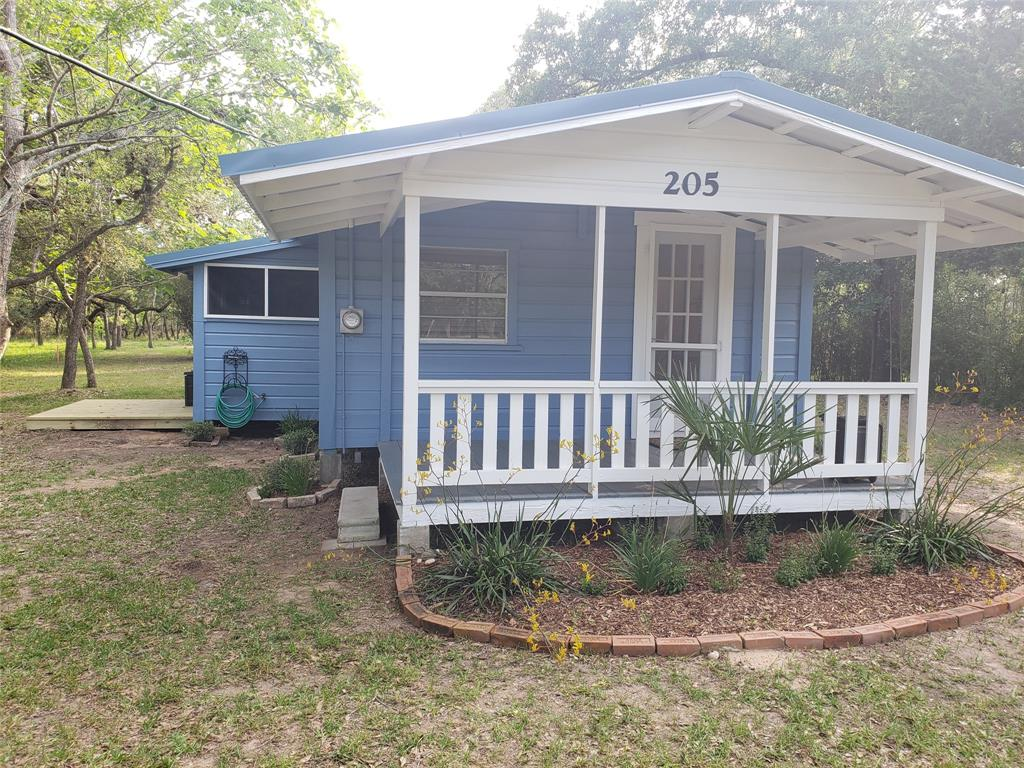 205 Hickory Dr Drive Property Photo - Sheridan, TX real estate listing