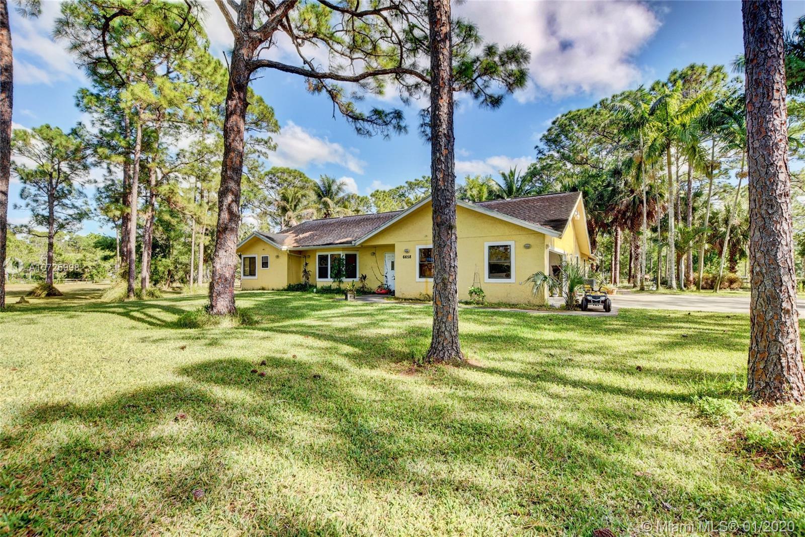 6658 N 140th Ave N Property Photo - West Palm Beach, FL real estate listing